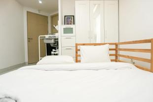 Simply White and Compact Studio at Amethyst Apartment By Travelio